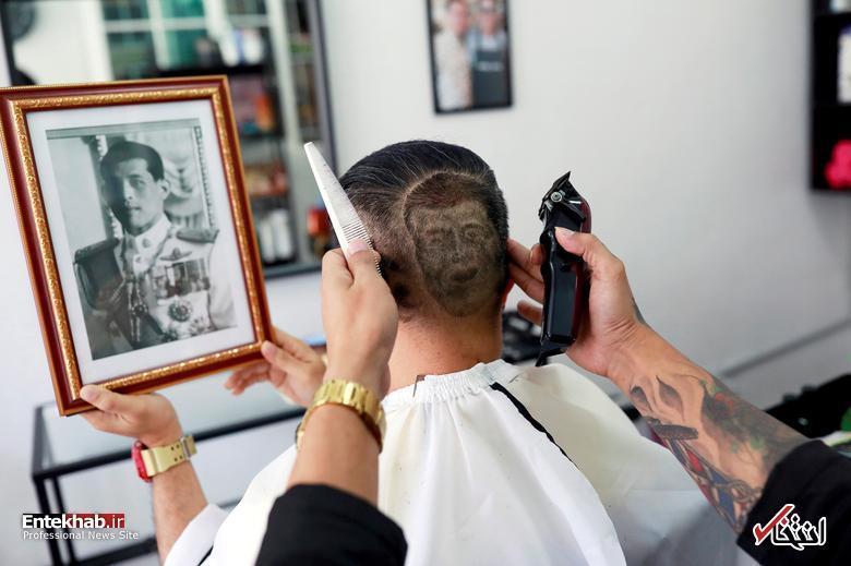 عکس: حک کردن تصویر پادشاه تایلند روی سر مشتری!